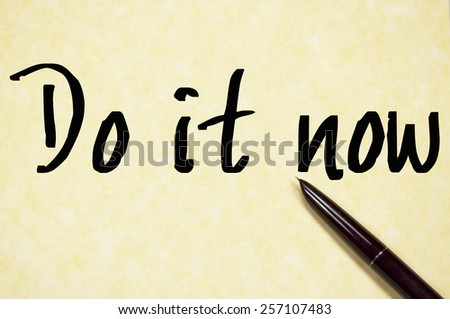 do it now text write on paper  - stock photo