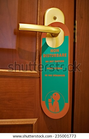 Do not disturb sign in italian hotel - stock photo
