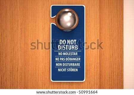 Do not disturb sign on a door knob - stock photo