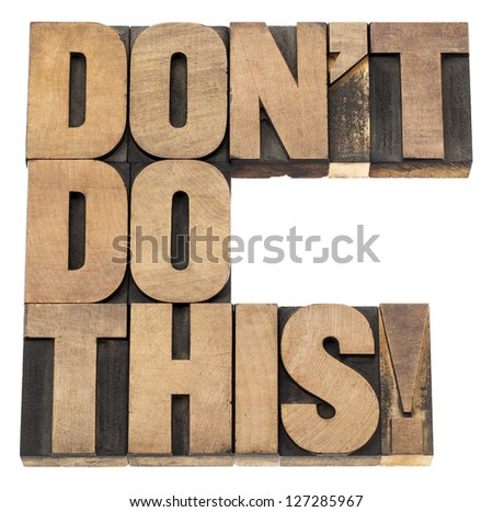 do not do this warning -  isolated text in vintage letterpress wood type printing blocks - stock photo