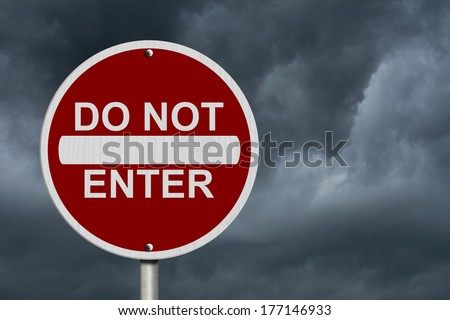 Do Not Enter Sign, A Round American road warning sign with words Do Not Enter with stormy sky - stock photo