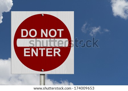 Do Not Enter Sign, A Square American road warning sign with words Do Not Enter with blue sky - stock photo