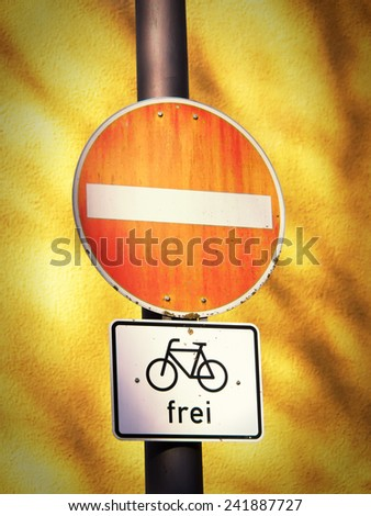do not enter traffic sign one way street, caution wrong direction, bicycles allowed, germany - stock photo