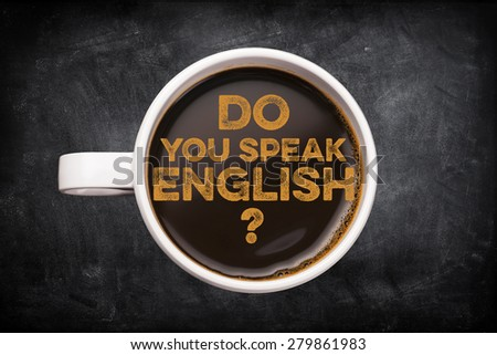 Do you speak english? coffee cup with blackboard background - stock photo