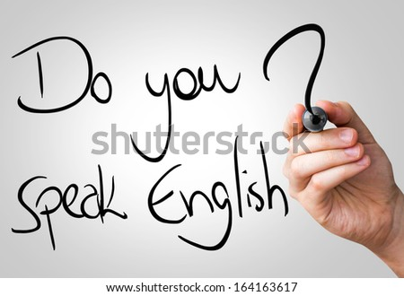 Do you speak English hand writing with a black mark on a transparent board - stock photo