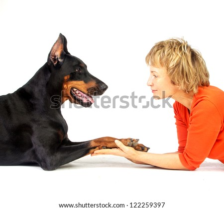 Doberman Dog and woman. Face to face, isolated on white. - stock photo