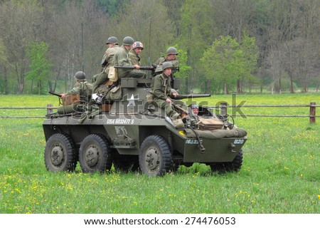 DOBRANY, CZECH REPUBLIC - MAY 1, 2015: American M8 Greyhound with soldiers. Liberation festival to 70th Anniversary of the Liberation by the US Army and the End of the Second World War in Europe. - stock photo