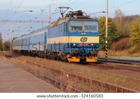 DOBRANY, CZECH REPUBLIC - OCTOBER 5, 2015: Express train Ceske drahy from Prague arriving to the railway station. Ceske drahy or Czech Railways is the main railway operator in the Czech Republic. - stock photo