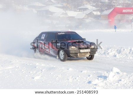 Dobryanka, Russia - February 7, 2015. Urban ice race. Black Lada VAZ-2114 racing on snow race track - stock photo