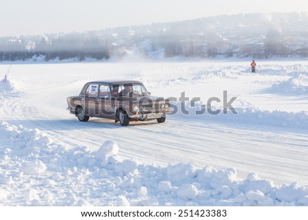Dobryanka, Russia - February 7, 2015. Urban ice race. Grey Lada VAZ-2107 goes on sports track ice racing - stock photo