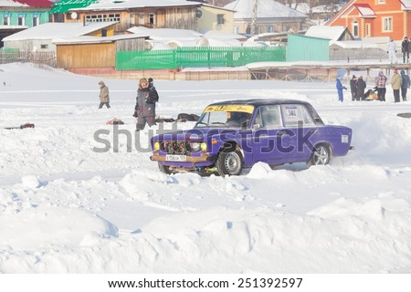 Dobryanka, Russia - February 7, 2015. Urban ice race. Purple car VAZ-2107 goes to the start of winter racing - stock photo