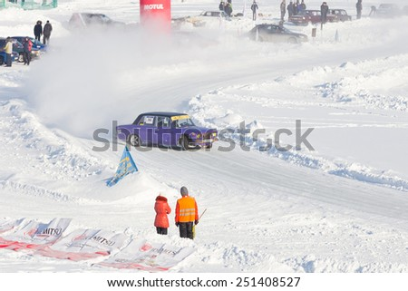 Dobryanka, Russia - February 7, 2015. Urban ice race. Purple VAZ-2107 on the ice road in winter - stock photo