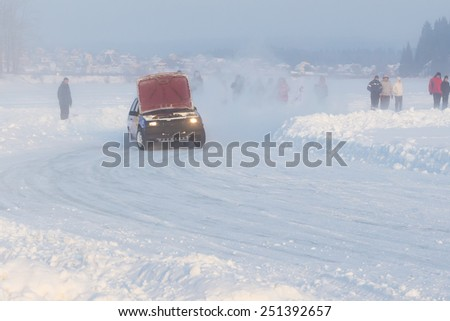 Dobryanka, Russia - February 7, 2015. Urban ice race. VAZ-2114 leaves the bend open the hood - stock photo