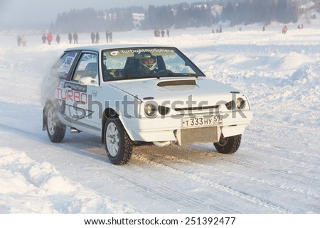 Dobryanka, Russia - February 7, 2015. Urban ice race. White VAZ-2114 on winter road - stock photo