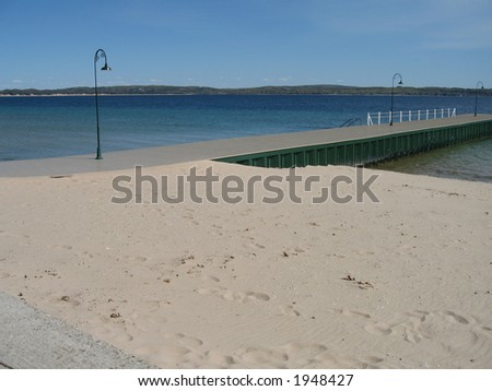 Dock Along the Sandy Beach in Paradise - stock photo