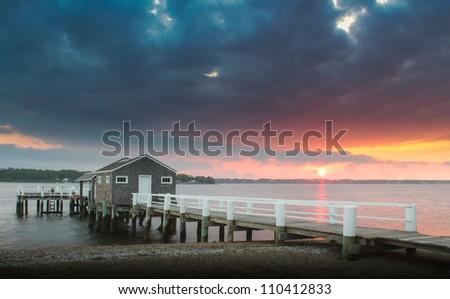 dock at sunset - stock photo