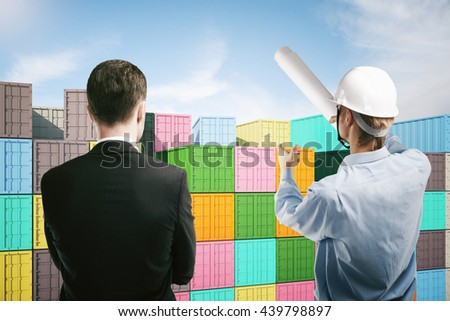 Dock worker pointing at colorful cargo containers and explaining something to businessperson. 3D Rendering - stock photo