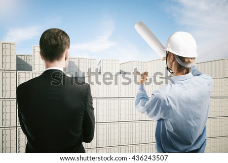 Dock worker pointing at colorless cargo containers and explaining something to businessman. 3D Rendering - stock photo