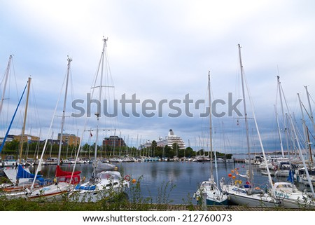 Docking yachts against the grey skies. A small marina with yachts in the harbor of Copenhagen Denmark - stock photo