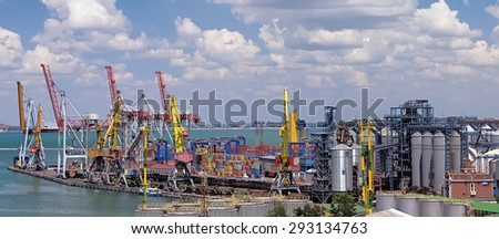 dockside cranes used for unloading container ships commercial container port - stock photo