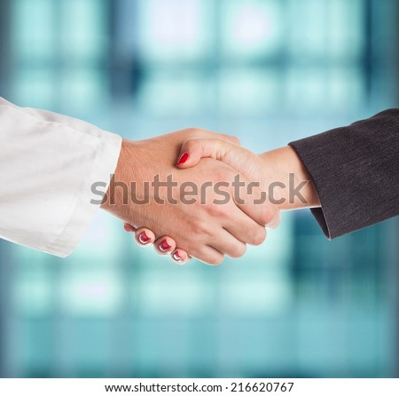 Doctor and female patient handshake - stock photo