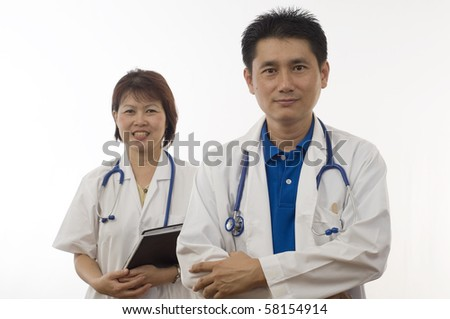 Doctor and Nurse standing isolated with white background - stock photo
