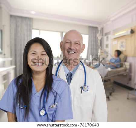 Doctor and Nurse with patient in hospital room - stock photo