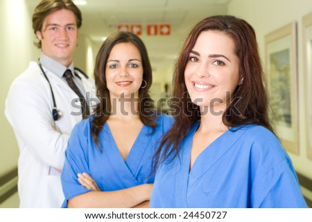 doctor and nurses in hospital - stock photo