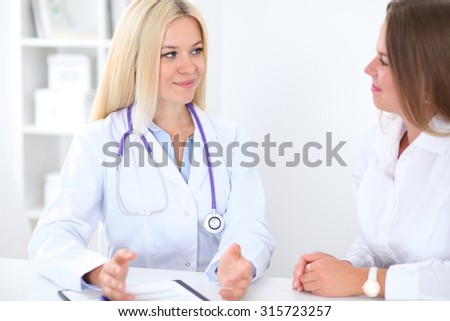 Doctor and patient  in hospital - stock photo