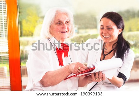 doctor and patient looking at  medical report - stock photo