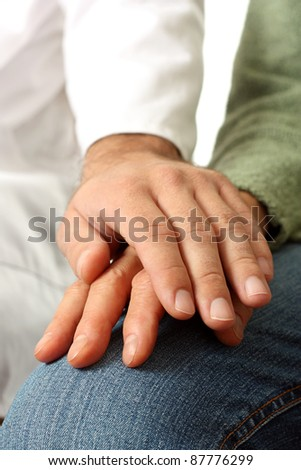 Doctor and senior patient hand - stock photo