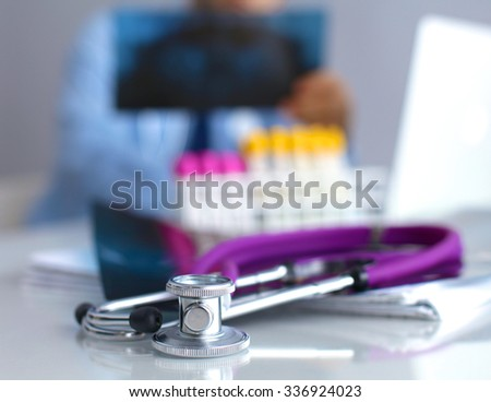 Doctor at work, close up of male doctor typing on a laptop - stock photo