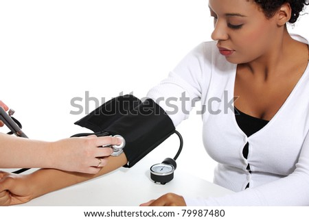 Doctor checking blood pressure of pregnant woman, isolated on white background - stock photo