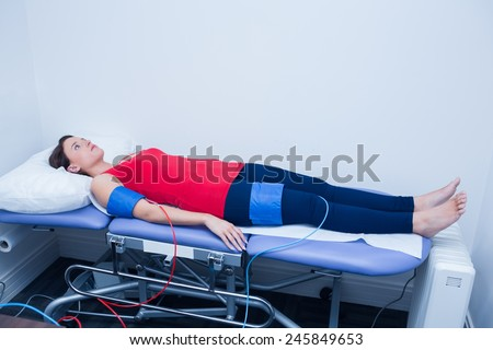 Doctor checking blood pressure of woman at medical office - stock photo