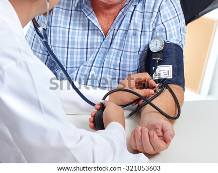 Doctor checking old man patient arterial blood pressure. Health care. - stock photo