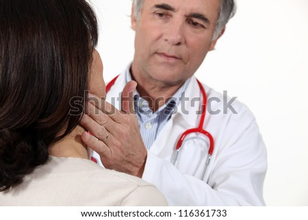 Doctor checking patient is well - stock photo