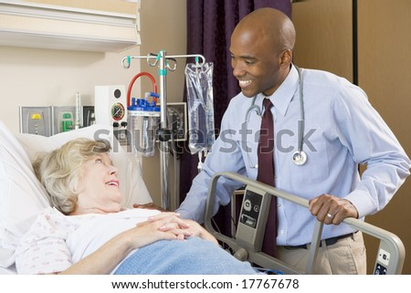 Doctor Checking Up On Patient In Hospital - stock photo