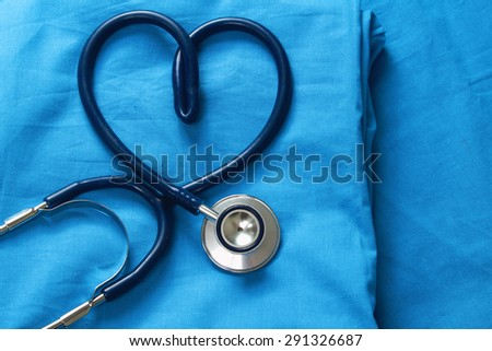 Doctor coat with stethoscope - stock photo