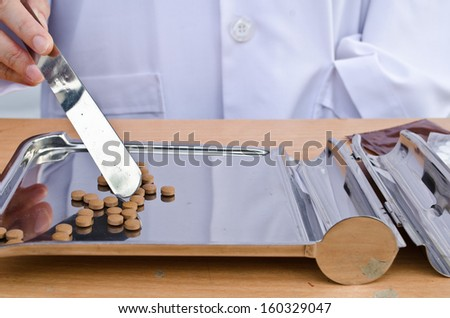 Doctor Counting tablets medicine - stock photo
