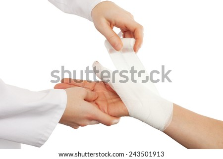 Doctor cover the hand of patient by bandage isolated - stock photo