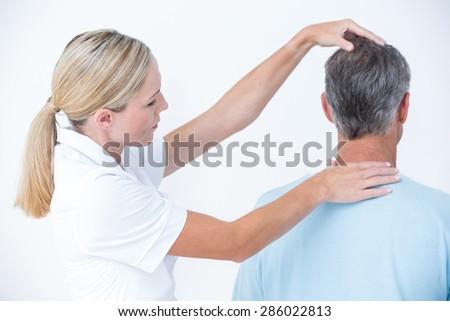 Doctor doing neck adjustment - stock photo