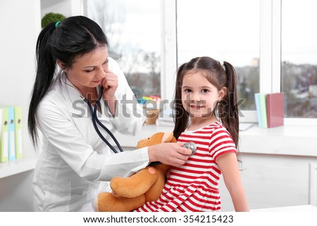 Doctor examining a child in the office - stock photo