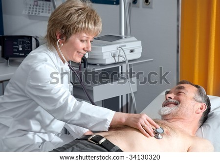 doctor examining an elderly patient - stock photo