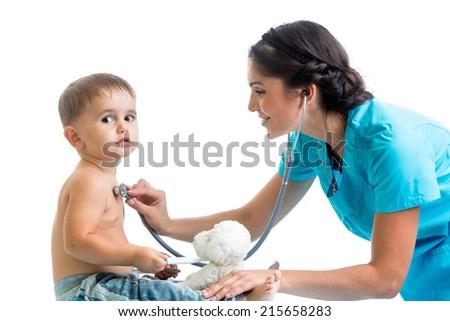 doctor examining child boy isolated on white - stock photo