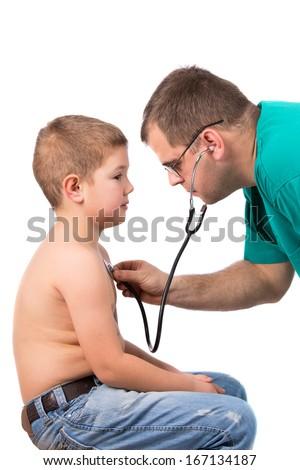 Doctor examining little boy in hospital - stock photo