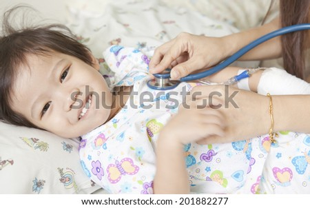 Doctor Examining little cute boy - stock photo