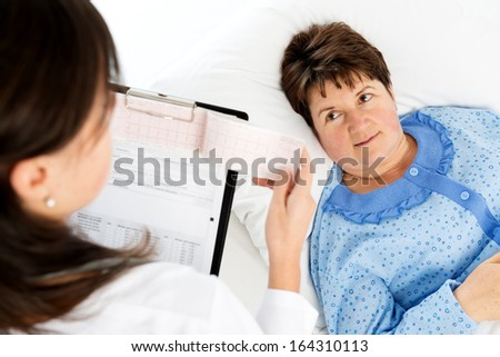 Doctor explaining medical results to senior woman - stock photo