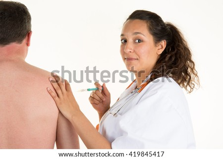 Doctor getting ready to inject patient with sterile syringe - stock photo