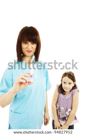Doctor getting ready to make an injection to a child.  Isolated over white background - stock photo