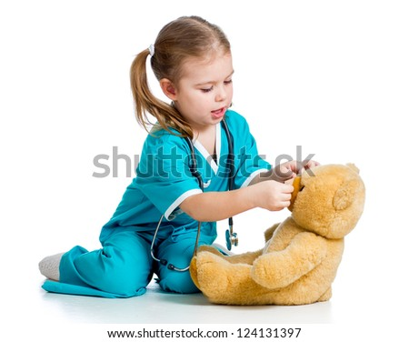 doctor girl playing and curing plush toy isolated on white background - stock photo